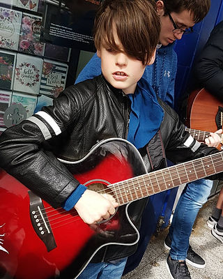 Music pupil playing guitar in Wellington