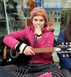 Girl singing while attending holiday programme in Wellington