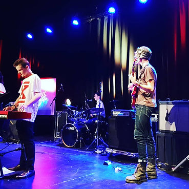 Young music pupils performing on stage at Smoke Free Rock Quest