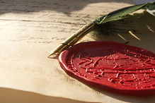 Prop photo of wax seal and quill