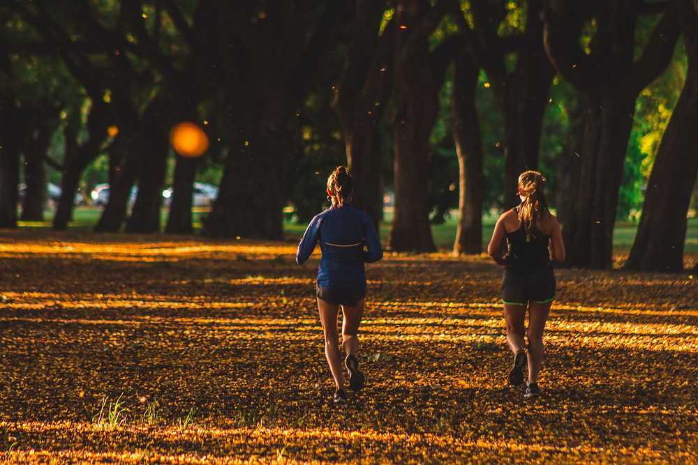 women-running-park-autumn