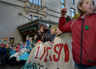 Thousands of people got together to protest climate inaction last October, energized by the presence of Greta Thunberg and other local environmental leaders. Young protesters sing and wave banners in front of the Fairmont Hotel, in downtown Vancouver. Vancouver, October 2019