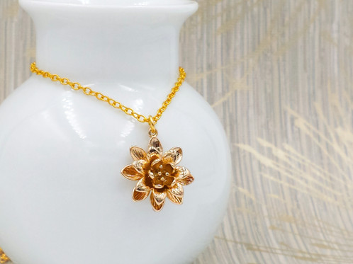 Gold lotus flower pendant necklace mysite this is a beautiful and elegant gold lotus flower pendant necklace lotus is a symbolic of purity and harmony the necklace features shinny gold plated mozeypictures Image collections