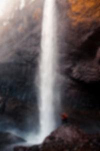 two-man-beside-waterfall.jpg