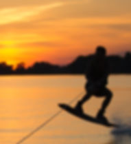 Silhouette Wakeboarder making tricks on