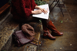woman-sitting-while-holding-book-1440896
