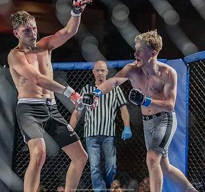 Tyler Sammis lands punch in MMA fight