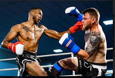 Tamir Johnson lands punch in Muay Thai f