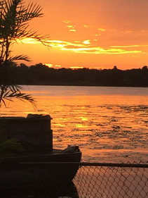 Photo of golden sunset on lake