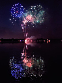 Photo of fireworks over lake