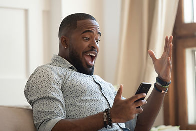 man looking at mobile phone with smiling happy expression