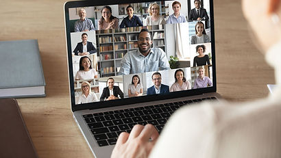 laptop screen with several images of people holding an online meeting