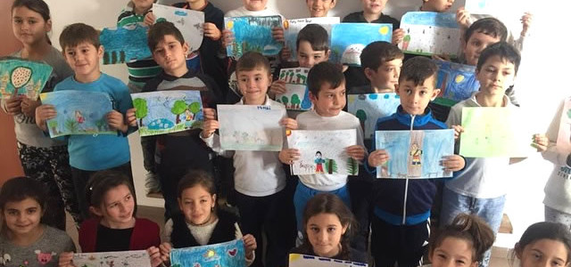 Creative children with their EarthToo drawings