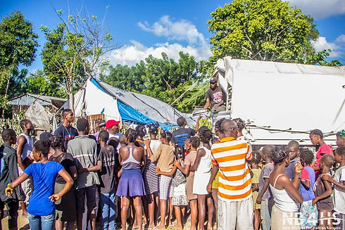 New Bridges for Haitian Success distributes food and supplies to the people of Belle-Anse.