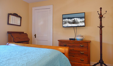 Antiques And TV In The Master