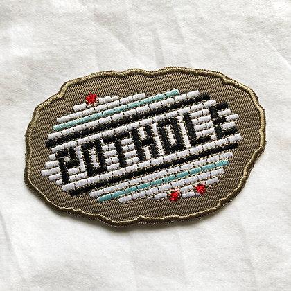 Deteriorating POTHOLE patch