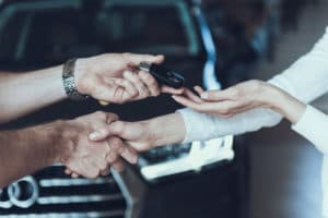 key hand off when purchasing a luxury car