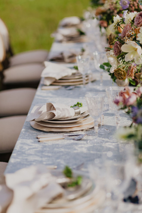 Long Wooden Table with Shadows of Flowers on the Place Settings