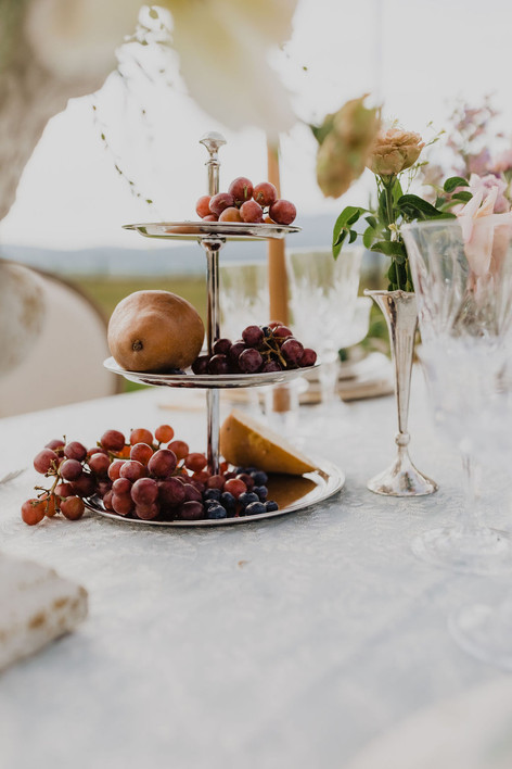 Cake Stand with Grapes and Pears on a Table