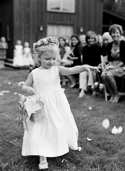Flower Girl Walking Down the Aisle Dropping Flowers