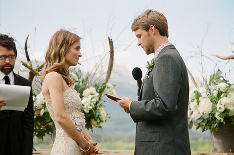 Groom Reading His Vows to a Bride