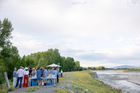 People Mingling on a Levy next to the Snake River