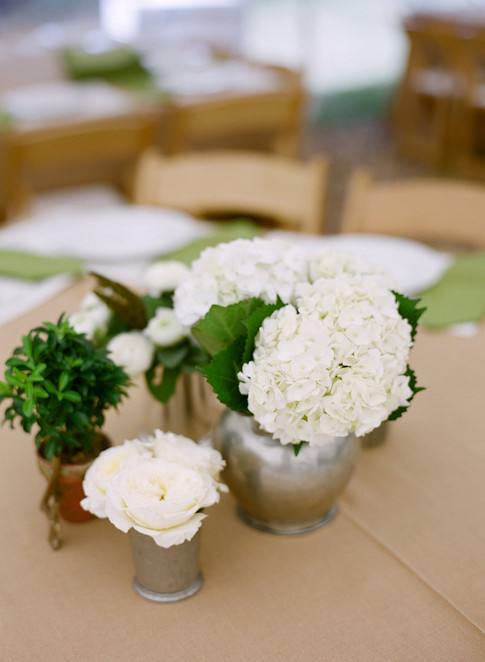 Cluster of Small Silver Vases filled with White Hydrangeas and White Roses