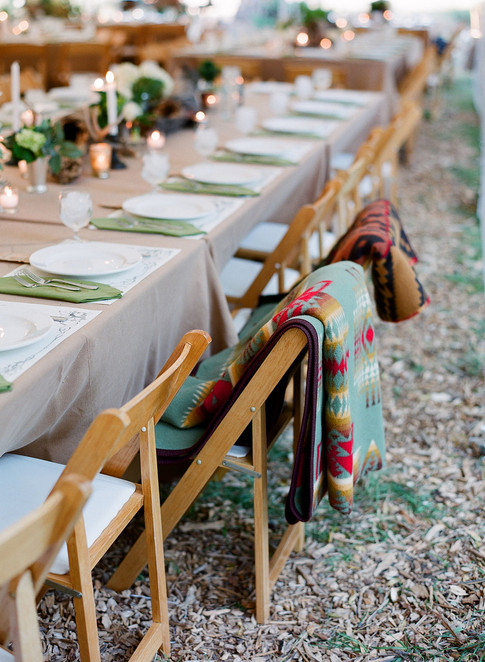 Long Table with White and Brown Charis with Pendleton Blankets folded on the Back