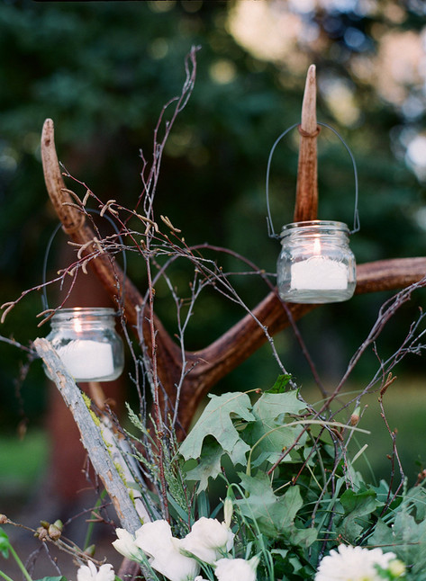 Small White Candles Hanging from an Antler