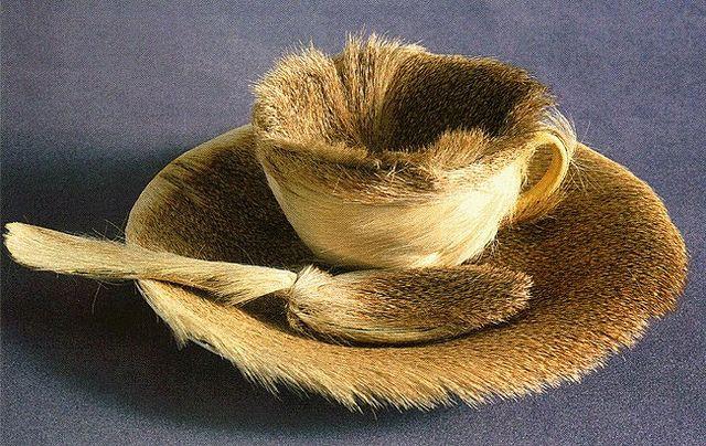 'Le Déjeuner en fourrure' (Breakfast in Fur) by Méret Oppenheim; a teacup, saucer, and spoon covered in fur, 1936