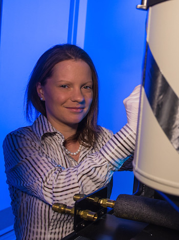 Rice University scientist Emilie Ringe, working at Rice's electron microscopy center, led a new study to establish that plasmonic nanoparticles can support catalysts without losing their beneficial optical properties. Photo by Jeff Fitlow