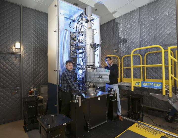 From left, Andrew Lupini and Juan Carlos Idrobo use ORNL's new monochromated, aberration-corrected scanning transmission electron microscope, a Nion HERMES to take the temperatures of materials at the nanoscale.  @ Oak Ridge National Laboratory, US Dept. of Energy; photographer Jason Richards