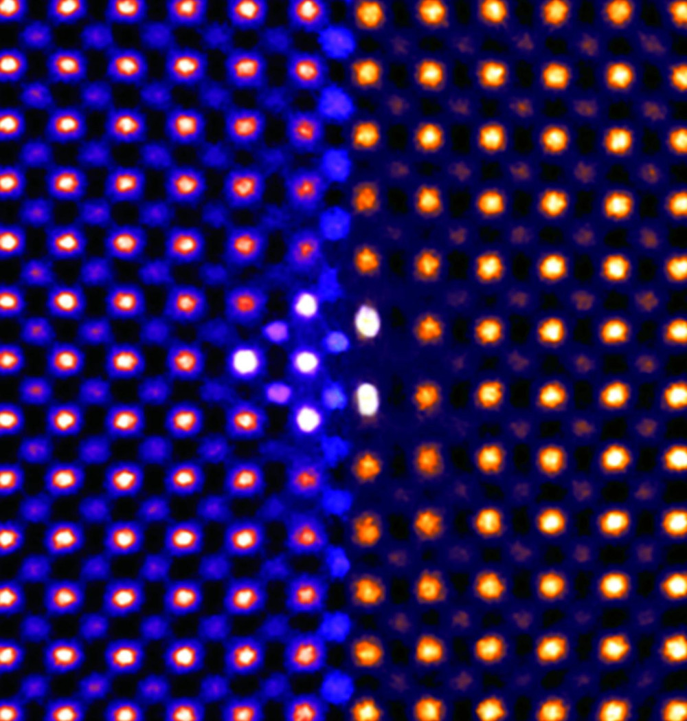 This colorized transmission electron microscopy of ceria ultrathin film reveals that individual atoms (shown as dots) shift under intense pressure. @ Sang Chul Lee