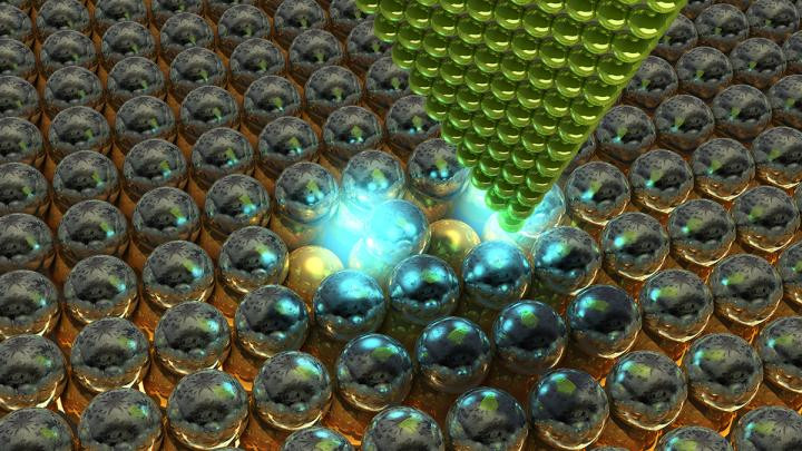 The tip of a scanning tunnelling microscope (STM) above chlorine atoms that have been deliberately moved. By moving individual atoms under their microscope, scientists were able to arrange vacancies in a single layer of chlorine atoms and create atomic lattices with a predetermined electrical response. @ Ella Maru Studio & Aalto University