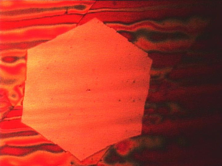 Visible to the naked eye: a wafer-thin graphene flake obtained via chemical vapor deposition. The red coloration of the copper substrate appears when the sample is heated in air. @ J. Kraus/ TUM