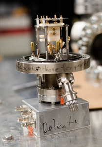 Using electrospray thrusters, like this one, space researchers could navigate with nanosatellites in space.