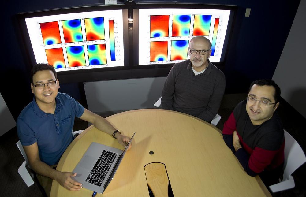 Sandia National Laboratories researchers Prashant Rai, left, Habib Najm, center, and Khachik Sargsyan discuss mathematical techniques used to study the behavior of large molecules at quantum scale. @ Dino Vournas