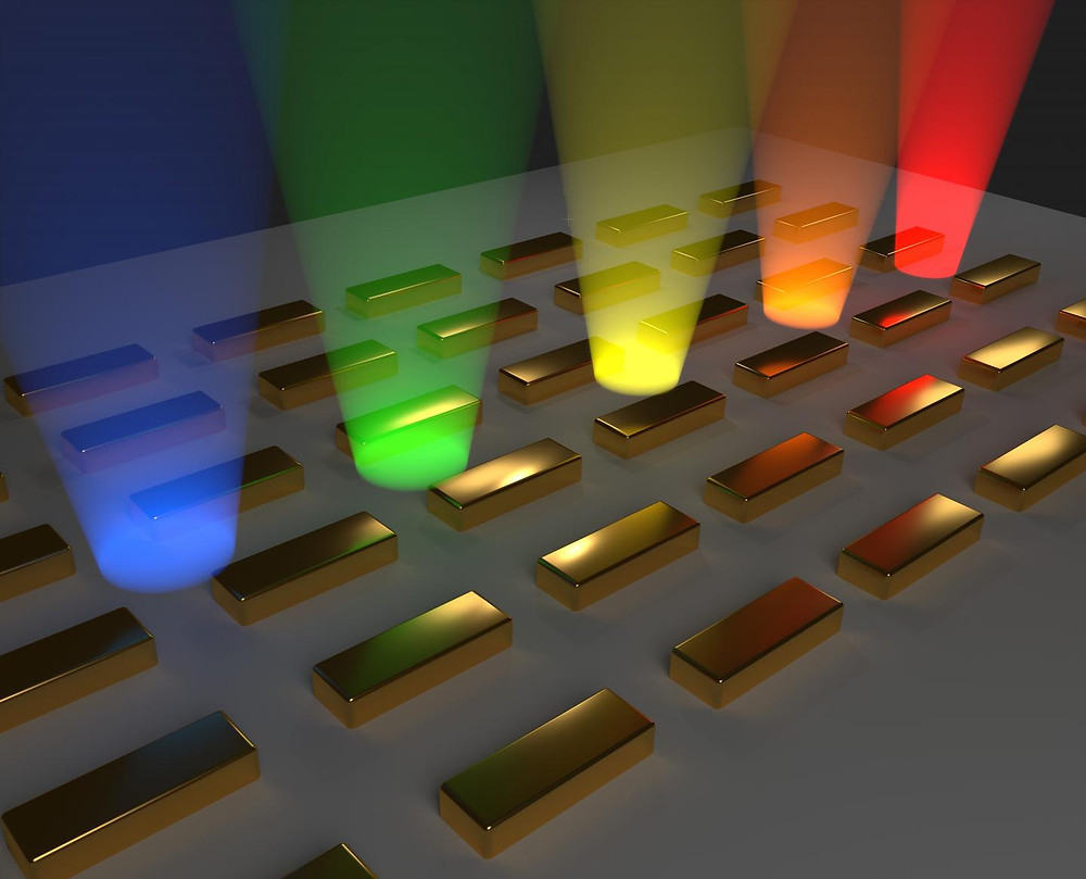 The wavelength of emitted light grows, that is, the energy decreases, along the gold nanorod array. A Bose-Einstein condensate forms when an energy minimum of the lattice is reached.  @ Aalto University / Tommi Hakala and Antti Paraoanu