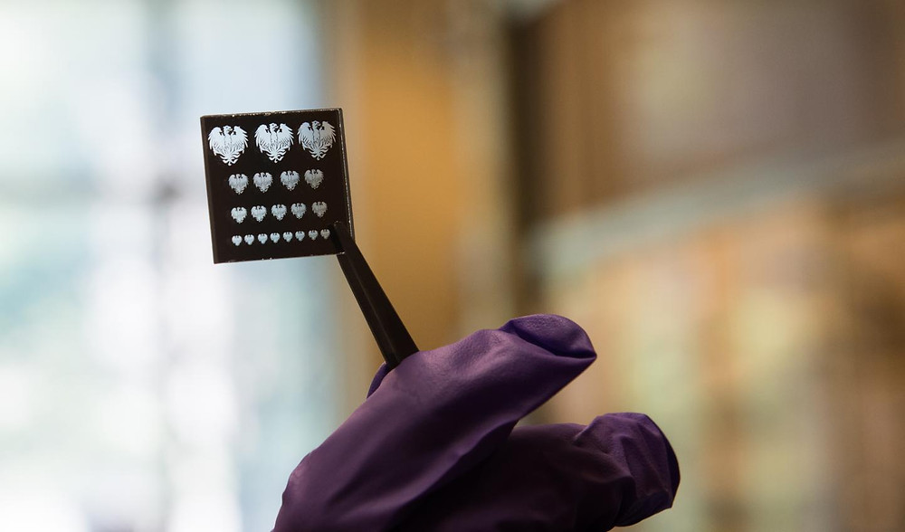 A 'mask' or stencil used to pattern nano materials with a new process that promises to make them far easier to make into LEDs, solar cells, transistors and other electronics. @ University of Chicago