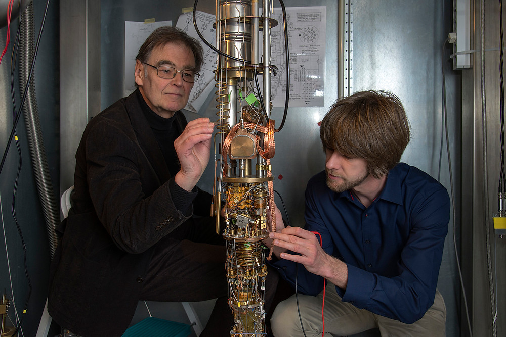 Erwin Schuberth (left) and Marc Tippmann with a high-performance cryostat at the Walther Meissner Institute in Garching, Germany. (Photo courtesy of Andreas Battenberg/Technical University of Munich)