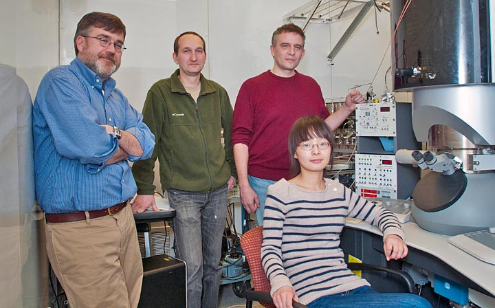 Collaborating scientists (left to right) Eric Stach, Dmitri Zakharov, Anatoly Frenkel, and Yuanyuan Li at a transmission electron microscope (TEM) in the Center for Functional Nanomaterials.
