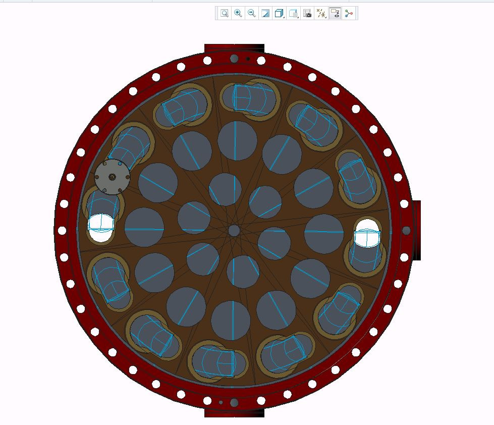 """Twelve photocathodes will be loaded into the apertures on the outside edge of this circular """"magazine,"""" which will fit inside the """"suitcase"""" that transports them to RHIC and inserts them into the electron gun. The circles closer to the center of the circle are holes to reduce the weight of the device and increase pumping to improve the vacuum in the chamber."""