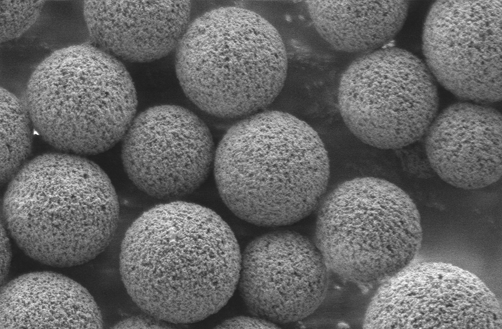 "A highly magnified portion of a ""puck"" studded with 10-micrometer beads in a single layer. Courtesy of the Macosko and Chen labs."