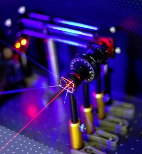 In the sensor, gold nanodisks are arranged in squares, shown bottom-left. The arrangement causes the sensor to emit UV light (in blue).  @ V.K Valev and D.C Hooper