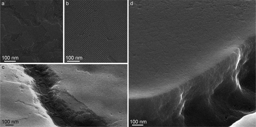 These images show scanning electron micrographs of the researchers' sample quantum dot films. The dark spots are the individual quantum dots, each about 5 nanometers in diameter. Images a and b show the consistent size and alignment of the quantum dots at the surface. The exposed edges in images c and d show depth and long-range ordering of the nanocrystals.  Image courtesy of the researchers