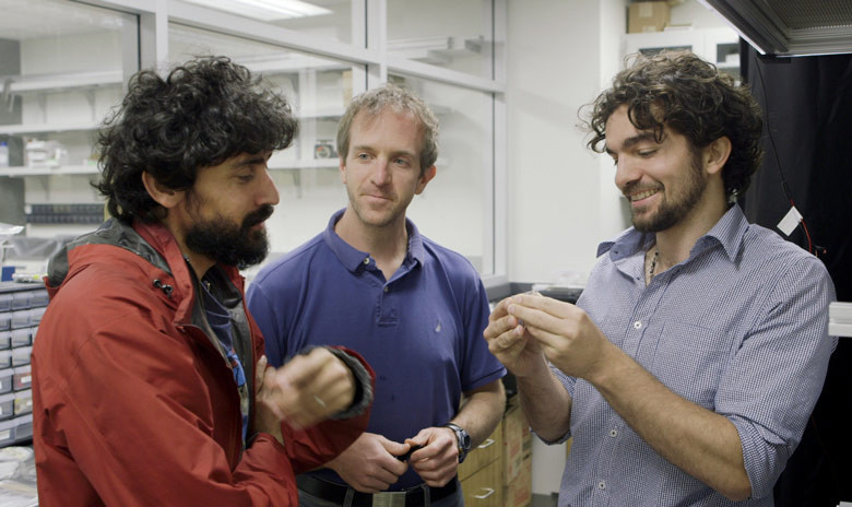 Stanford Assistant Professor Manu Prakash, left, and graduate students Jim Cybulski and Georgios Katsikis developed the water drop computer. Image: Kurt Hickman