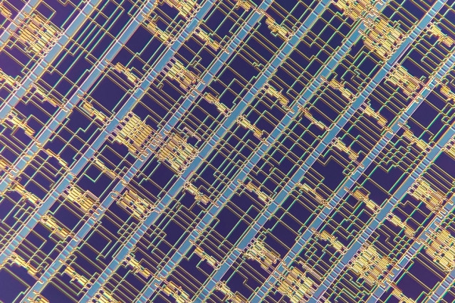 A microscopic image of a modern microprocessor built from carbon nanotube field-effect transistors.  Image: Felice Frankel