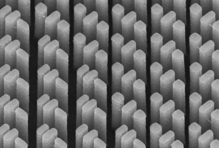 This is an SEM image of the metacorrector. The refractive index of each nanopillar can be tuned and controlled so that all wavelengths are brought to the same focal point.  @ Harvard SEAS