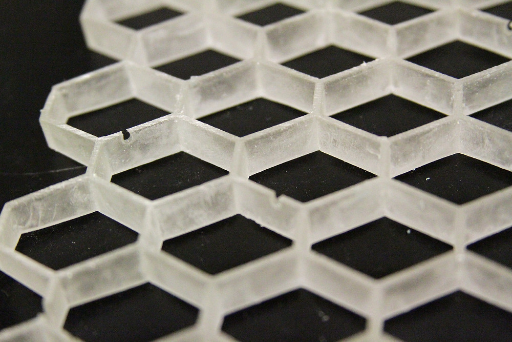 """New research has shown that honeycomb """"cellular"""" materials made of a shape-memory polymer might be programmed for specific purposes, from shock-absorbing football helmets to biomedical implants. (Purdue University image/Pablo Zavattieri)"""