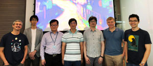 The IMRE and DSI team involved in this research, standing in front of their reproduction of Kandinsky's Murnau Street with Women.  © 2018 A*STAR Institute of Materials Research and Engineering